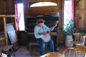 Jay with the banjo at the piano